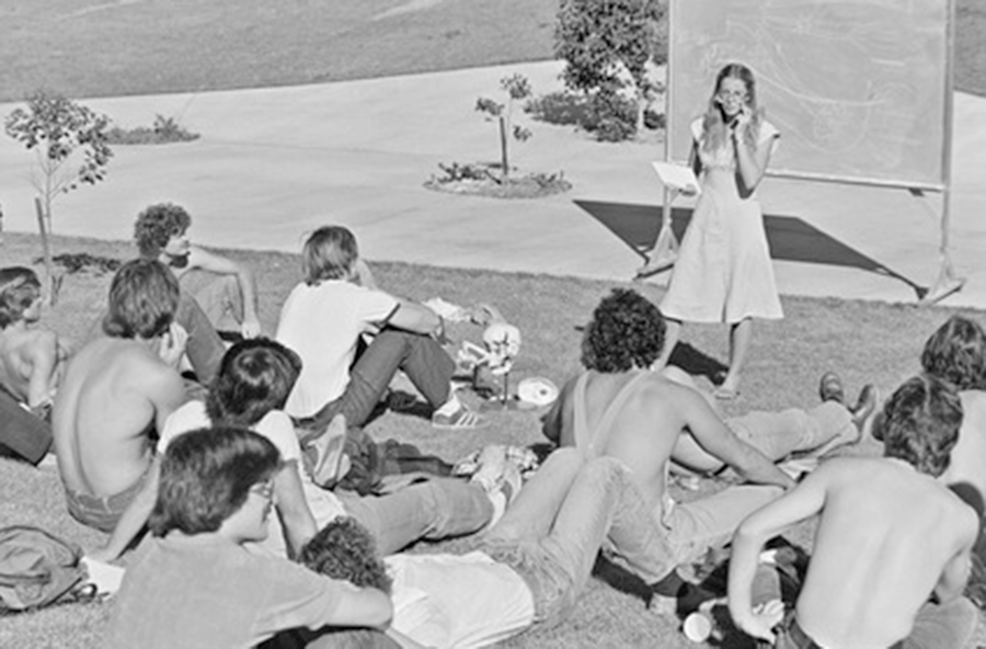 Students from 1980 at outdoor lecture