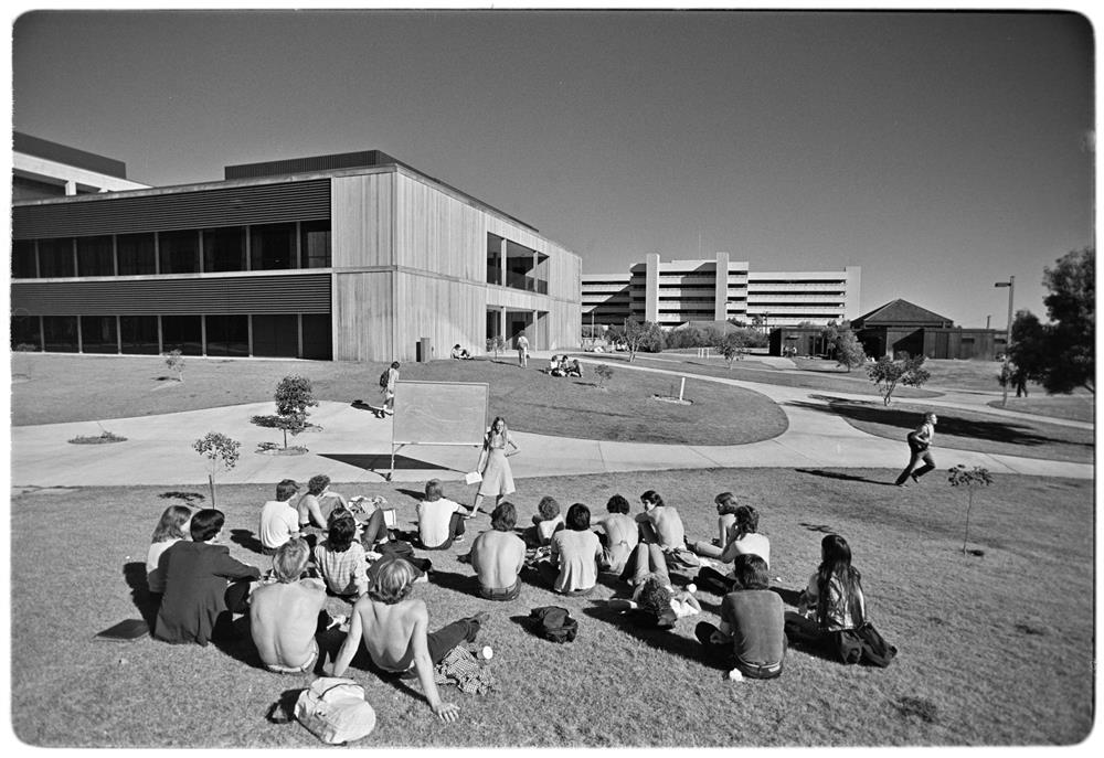 Students from the 1980s learning outside