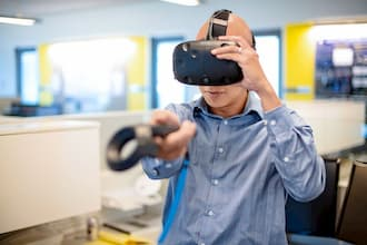 Man standing using virtual reality head piece technology