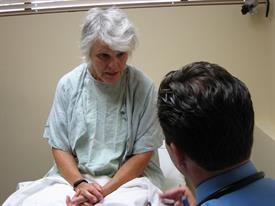 Doctor talking with standardized patient