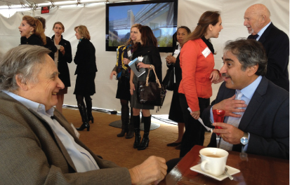 David Altman, Steve's father, and Chancellor Khosla chat at the lunch following the groundbreaking ceremony.