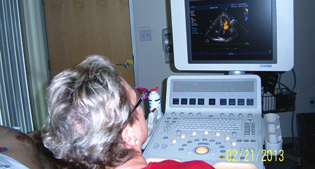 Nancy Dalton performing a cardiac echo