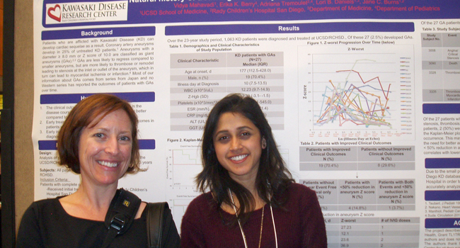 Jill Dumbauld (left), CTRI Education, Training and Career Development Program Manager, chats with CTRI TL1 student Vidya Mahavadi, who conducted research about the performance of a proposed diagnostic panel for Kawasaki Disease.