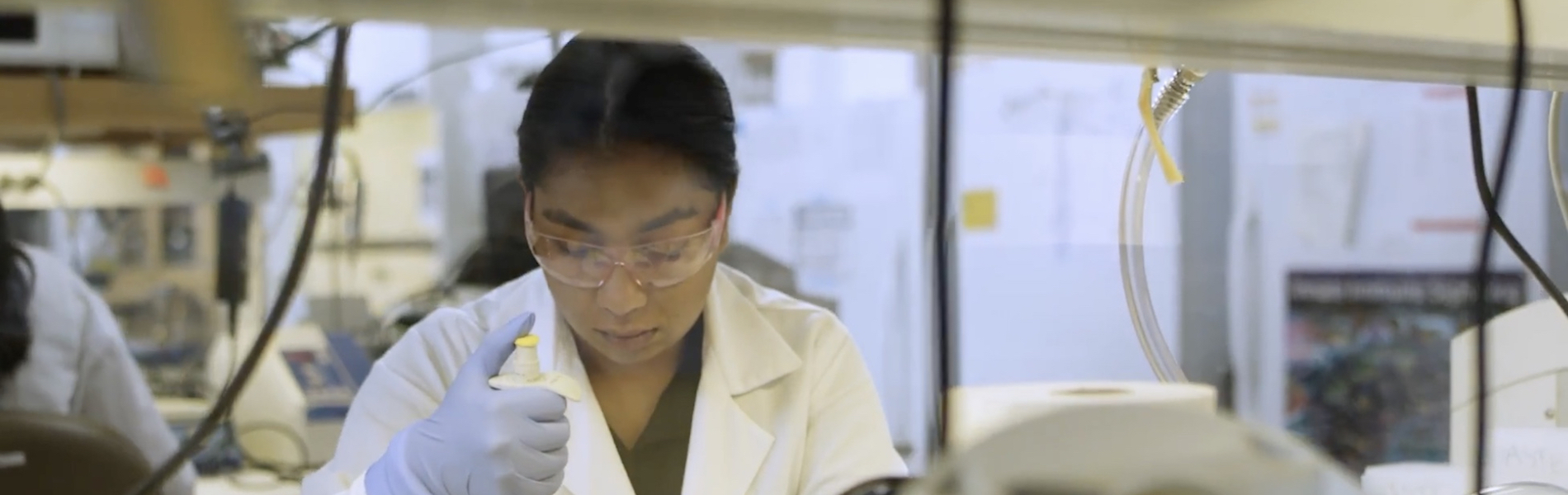female researchers pipetting in a lab