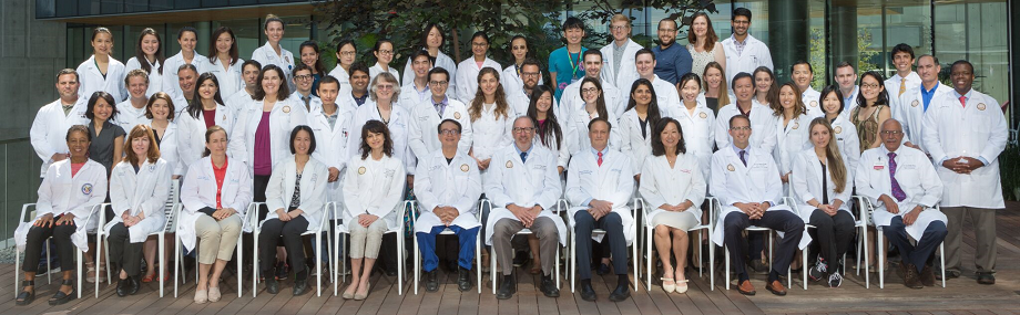 Over 50 members of Dermatology department, including faculty and staff, many wearing white lab coats