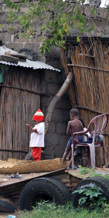 Children playing in cane village outside Maputo, Mozambique