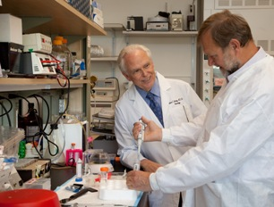 William Mobley and Pavel Belichenko in the lab