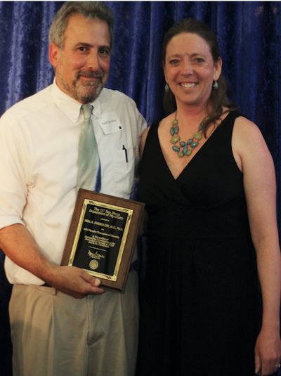 Neal Swerdlow receiving award