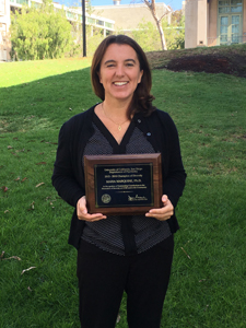 Maria Marquine with Champion of Diversity Award Plaque