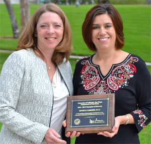 Lisa Eyler and Monica Ulibarri with award plaque