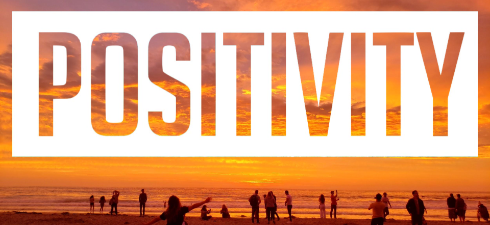 Text positivity over an image of people at the beach during sunset